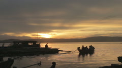 Boat Departing on the Irrawaddy River at Sunset in Mandalay Burma (Myanmar) Stock Footage