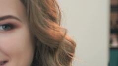 Portrait of a girl with a haircut waves. Closeup - stock footage