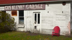 An attractive old weathered garage along a rural road in America. Stock Footage