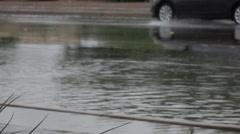 Extreme weather soft focus slo mo truck splashes thru flooded street Stock Footage