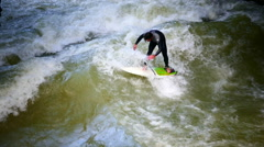 Extreme Sport Board Surfing in Munich Eisbach River Germany Europe Stock Footage