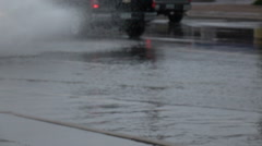 Extreme weather slo mo SUV drives with a punch on flooded street Stock Footage
