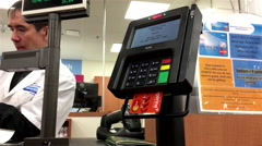 Man paying credit card while pharmacist explaining prescription to him Stock Footage