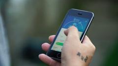 Samara, Russia - man playing pokemon go on his smartphone Stock Footage