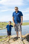 Father And Son Hugging On Outdoor summer - stock photo