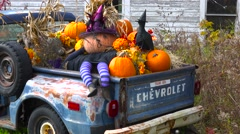 Autumn or fall is welcomed in with a homemade Halloween display in the back of a Stock Footage