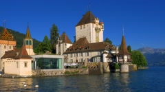 Oberhofen Castle on Lake Thun, Bernese Oberland, Switzerland, Europe Stock Footage