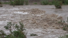 4K UHD extreme weather rushing flood waters in the desert flash flood with sound Stock Footage