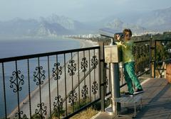 Little cute boy looking through telescope at sea viewpoint in Ataturk park Stock Photos