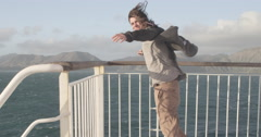 Tourist enjoying breeze on ship Stock Footage