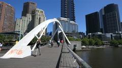 Australia Melbourne foot bridge arches over Yarra River Stock Footage