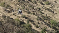 Aerial of helicopter flying over landscape Stock Footage