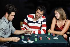 Young people playing poker off-line tournament, friends party concept Stock Photos
