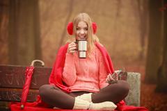 Young woman holding thermal mug. Stock Photos