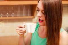 Woman drinking hot coffee beverage. Caffeine. - stock photo