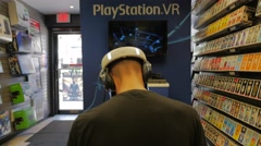 Virtual Reality Headset Experience Male Sony Playstation VR Store Demo Stock Footage