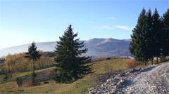 Mountains Silhouette and Autumn Foliage Stock Footage