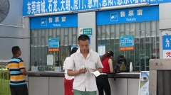Shenzhen, China: passengers are buying tickets at the bus stop Stock Footage
