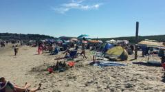 New England Beach with Beachgoers Stock Footage