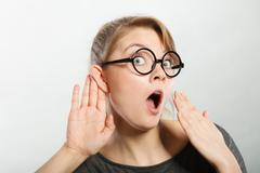Shocked girl eavesdropping. Stock Photos