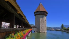 Chapel Bridge and Water Tower in Lucerne, Switzerland, Europe Stock Footage