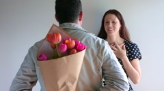 Man gives tulip flowers to his lover Stock Footage