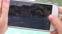 4K Tourist woman hand take photo with mobile phone to sea coastline Corfu Island Stock Footage