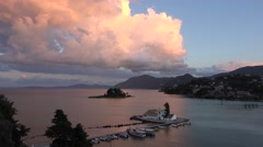 4K Aerial view Pontikonisi Island Vlacherna Monastery at sunset Corfu landmark Stock Footage