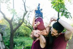 Young family with a child on the nature Stock Photos