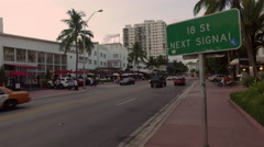 Street sign and cars passing on Collins Ave, Miami Beach Stock Footage