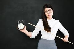 asian teacher is very angry for a student who always late - stock photo
