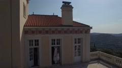 Bride touch wedding dress balcony terrace of castle in European mountain aerial Stock Footage