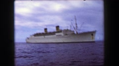 1958: Luxurious ocean liner cruise ship against dark gray stormy clouds. Stock Footage