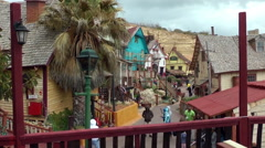 Tourists in Popeye  Village, Malte on cold day Stock Footage