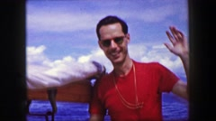 1958: Nerdy man in red shirt steering boat captain wheel in choppy waters.  Stock Footage
