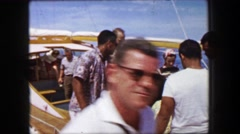 1958: Tourists exiting cruise boat at tour completion in tropical colorful Stock Footage