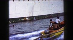 1958: Pirate gang of boys jump out raft to illegally board ocean liner cruise - stock footage