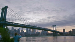 Manhatten bridge with the distinctive New York skyline at sunset Stock Footage