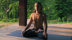 The man on the mat adjusted to meditation - stock footage