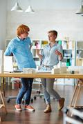 Two designers discussing new tendencies in modern architecture Stock Photos