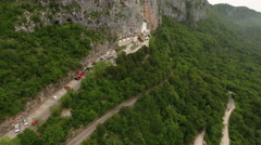 Hairpin road to the upper Ostrog Serbian Orthodox monastery and parking lot Stock Footage