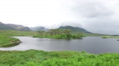 View to island in lake or river at ireland  18 Stock Footage