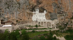 House of the Church of the Holy Cross is in Ostroska Greda cliff, Montenegro Stock Footage