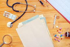 Assorted office supplies on general medical practitioner work desk Stock Photos