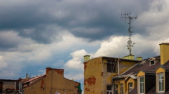 4k apartment roofs clouds above europian city 4k timelapse Stock Footage