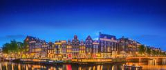 Amsterdam old buildings and Amstel river, Holland Stock Photos