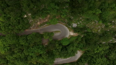 Car driving on hairpin road. The only way to upper church of Monastery of Ostrog Stock Footage