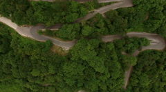 Hairpin road is the way to upper church of Monastery of Ostrog, Montenegro Stock Footage