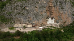 The Orthodox monastery of Ostrog is in Ostroska Greda. Drone flying to buildings Stock Footage