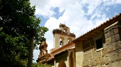 Storks nesting on a church in spring Stock Footage
